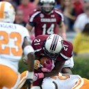 South Carolina running back Marcus Lattimore (21) is hit by Tennessee's Eric Gordon during the first half of an NCAA college football game Saturday, Oct. 27, 2012 at Williams-Brice Stadium in Columbia, S.C. Lattimore was injured on the play. (AP Photo/Richard Shiro)
