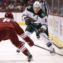 Minnesota Wild's Mikko Koivu (9), of Finland, flips the puck past Arizona Coyotes' David Schlemko (6) during the first period of an NHL hockey game Saturday, Dec. 13, 2014, in Glendale, Ariz The Associated Press