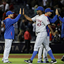 New York Mets relief pitcher Jose Valverde, right, high-fives teammates after closing out the ninth inning to end a baseball game against the Atlanta Braves, Tuesday, April 8, 2014, in Atlanta The Associated Press