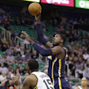 Indiana Pacers' Roy Hibbert, right, shoots as Utah Jazz's Derrick Favors (15) defends in the first quarter during an NBA basketball game Wednesday, Dec. 4, 2013, in Salt Lake City The Associated Press