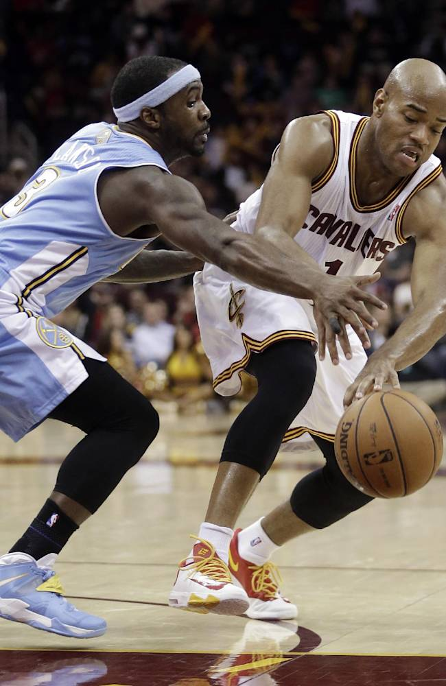 Denver Nuggets' Ty Lawson, left, puts pressure on Cleveland Cavaliers' Jarrett Jack during the fourth quarter of an NBA basketball game on Wednesday, Dec. 4, 2013, in Cleveland. The Cavaliers won 98-88
