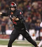 Fresno State's Derek Carr, left, slings a pass downfield as Nevada's Lenny Jones chases in the first half of an NCAA college football game in Fresno, Calif., Saturday, Nov. 2, 2013. (AP Photo/Gary Kazanjian)