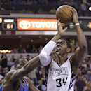 Sacramento Kings forward Jason Thompson, right, is fouled by Oklahoma City Thunder center Kendrick Perkins during the third quarter of an NBA basketball game, Tuesday, April 8, 2014, in Sacramento, Calif. The Thunder won 107-92 The Associated Press