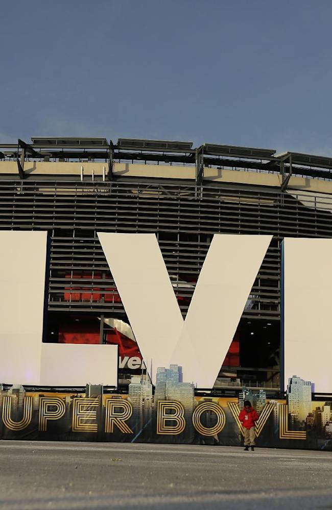 A sign for NFL football's Super Bowl XLVIII stands in front of MetLife Stadium Sat. Feb. 1, 2014, in East Ruthoford, N.J. The stadium will be the site of Sunday's championship game between the Denver Broncos and the Seattle Seahawks