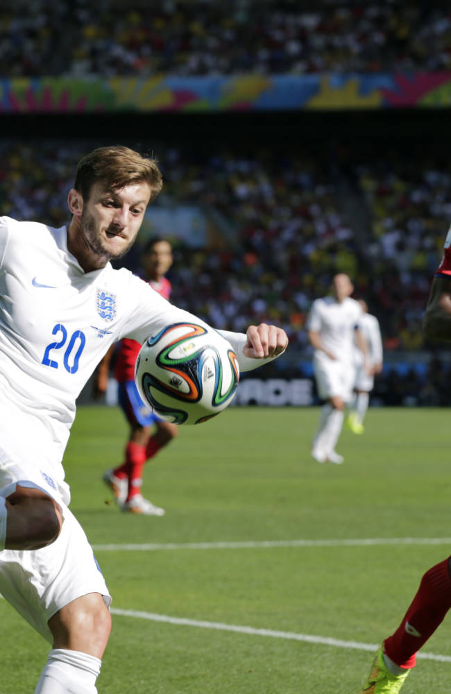 England's Adam Lallana kicks a cross as Costa Rica's Roy Miller defends during the group D World Cup soccer match between Costa Rica and England at the Mineirao Stadium in Belo Horizonte, Brazil, Tuesday, June 24, 2014