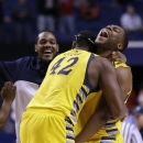 Marquette's Chris Otule (42) and Davante Gardner celebrate after defeating Butler 74-72 in a third-round NCAA college basketball tournament game on Saturday, March 23, 2013, in Lexington, Ky. (AP Photo/John Bazemore)