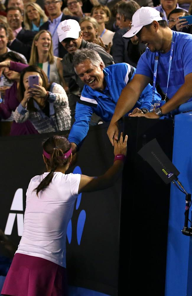 Li Na of China celebrates with her husband Jiang Shan, right, and support team members after defeating Dominika Cibulkova of Slovakia in their women's singles final at the Australian Open tennis championship in Melbourne, Australia, Saturday, Jan. 25, 2014