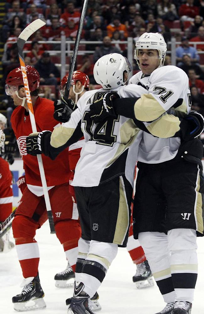 Penguins' Malkin hurts left leg against Red Wings