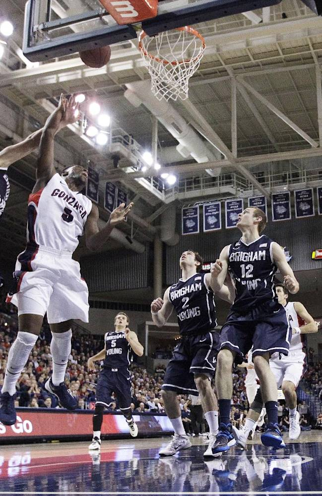 Gonzaga's Gary Bell Jr. (5) attempts a layup while being defended by BYU's Tyler Haws (3) during the second half of an NCAA college basketball game, on Saturday, Jan. 25, 2014, in Spokane, Wash. Gonzaga won 84-69