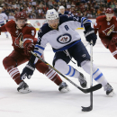 Winnipeg Jets right wing Blake Wheeler (26) drives on Arizona Coyotes defenseman Connor Murphy (5) in the first period during an NHL hockey game, Thursday, Jan. 8, 2015, in Glendale, Ariz The Associated Press
