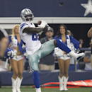 Dallas Cowboys wide receiver Dez Bryant (88) makes a touchdown reception during the first half of an NFL preseason football game against the Baltimore Ravens, Saturday, Aug. 16, 2014, in Arlington, Texas The Associated Press