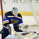 St. Louis Blues' goalie Brian Elliott (1) blocks a shot against the Calgary Flames during the third period of an NHL hockey game, Saturday, Oct. 11, 2014, in St. Louis The Associated Press