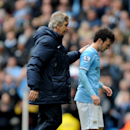 Manchester City manager Manuel Pellegrini, left, pats David Silva on the back after he is substituted during the English Premier League soccer match between Manchester City and Southampton at The Etihad Stadium, Manchester, England, Saturday, April 5, 2