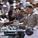 San Diego Padres' Nick Hundley returns to the dugout after his solo home run against the San Francisco Giants in the seventh inning a baseball game Sunday, April 20, 2014, in San Diego The Associated Press