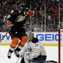 Anaheim Ducks right wing Corey Perry leaps over the stick of Buffalo Sabres goalie Michal Neuvirth during the second period of an NHL hockey game in Anaheim, Calif., Wednesday, Oct. 22, 2014 The Associated Press