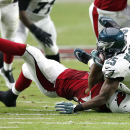 Philadelphia Eagles running back LeSean McCoy (25) is tackled by Arizona Cardinals outside linebacker Alex Okafor during the first half of an NFL football game, Sunday, Oct. 26, 2014, in Glendale, Ariz The Associated Press