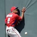 Philadelphia Phillies center fielder Ben Revere can't catch a pop fly at the wall on a triple by Minnesota Twins Deibinson Romero in the seventh inning of an exhibition baseball game in Fort Myers, Fla., Sunday, March 9, 2014 The Associated Press