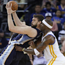 Memphis Grizzlies center Marc Gasol, left, posts up next to Golden State Warriors' Jermaine O'Neal during the second half of an NBA basketball game Friday, March 28, 2014, in Oakland, Calif. Golden State won 100-93 The Associated Press
