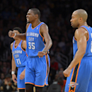 Oklahoma City Thunder small forward Kevin Durant, center, celebrates between shooting guard Jeremy Lamb, left, and point guard Derek Fisher during the second half of an NBA basketball game against the Los Angeles Lakers, Thursday, Feb. 13, 2014, in Los An