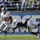 New York Giants wide receiver Victor Cruz, left, avoids San Diego Chargers cornerback Richard Marshall as he runs with a reception during the second half of an NFL football game on Sunday, Dec. 8, 2013, in San Diego The Associated Press