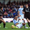Queens Park Rangers' Karl Henry, center, tussles with Burnley's Dean Marney, right, and George Boyd during the English Premier League soccer match at Loftus Road, London, Saturday Dec. 6, 2014