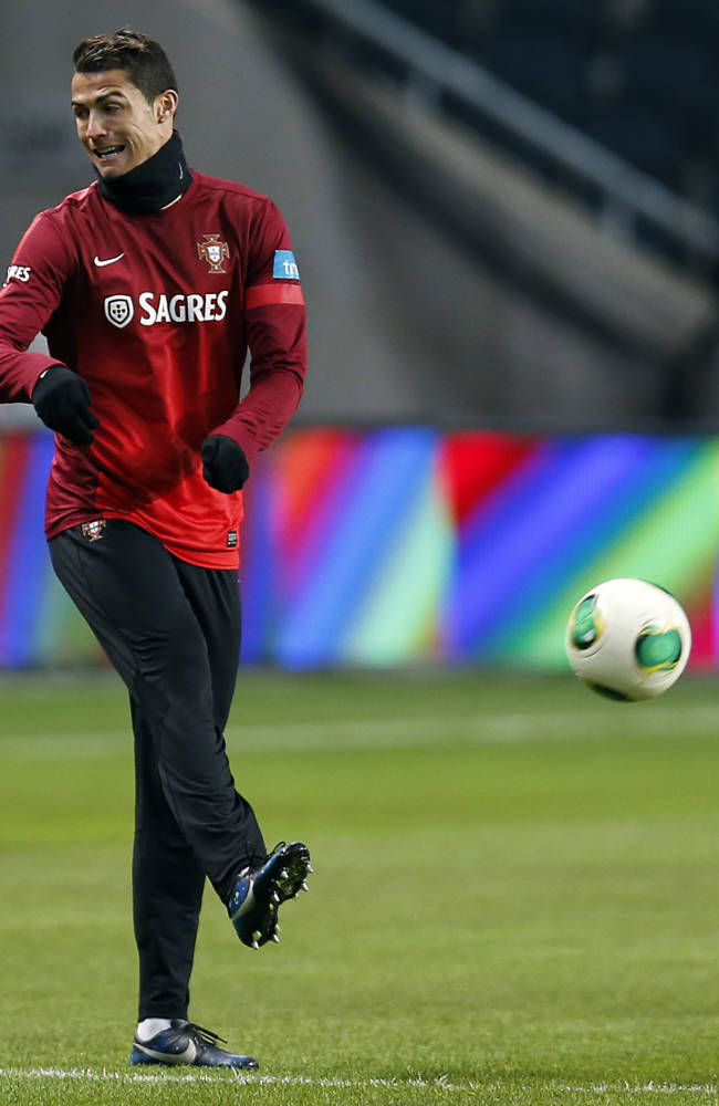 Portugal's Cristiano Ronaldo kicks a ball during a training session one day ahead of the World Cup qualifying playoff second leg soccer match between Sweden and Portugal in Stockholm, Sweden, Monday, Nov. 18, 2013