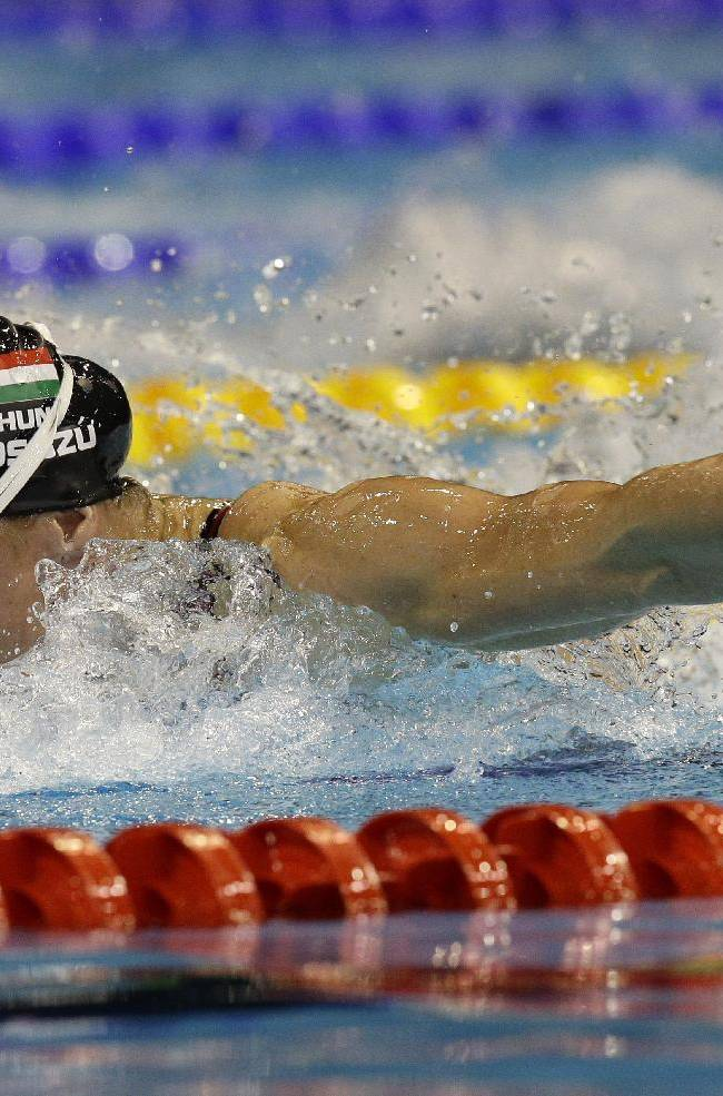 Hungary's Katinka Hosszu competes in a women's 200m butterfly heat at the LEN Swimming European Championships in Berlin, Germany, Saturday, Aug. 23, 2014