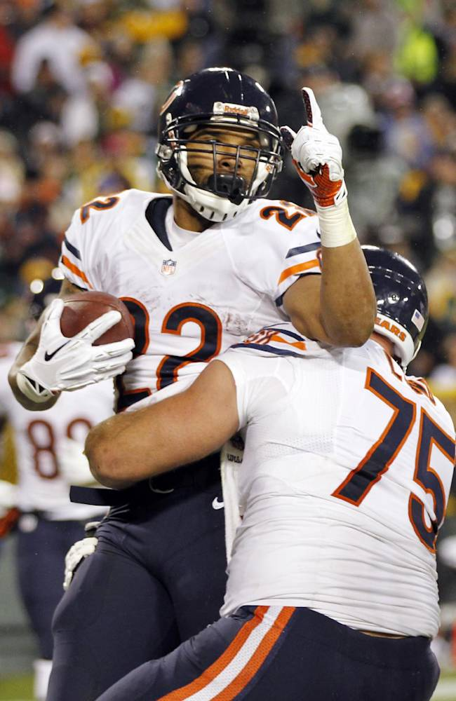 Chicago Bears' Matt Forte (22) celebrates his touchdown run with teammate Kyle Long (75) during the first half of an NFL football game against the Green Bay Packers Monday, Nov. 4, 2013, in Green Bay, Wis