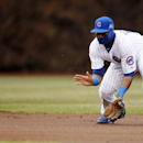 Chicago Cubs shortstop Starlin Castro fields a ground ball hit by the Philadelphia Phillies' Ben Revere for an out at first base during the first inning of a baseball game on Friday, April 4, 2014, in Chicago The Associated Press