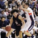 Lewis-Clark State's Jacob Champoux (11) dribbles around Gonzaga's Kyle Dranginis, right, during the first half of an NCAA college basketball game in Spokane, Wash., Thursday, Nov. 29, 2012. (AP Photo/Young Kwak)
