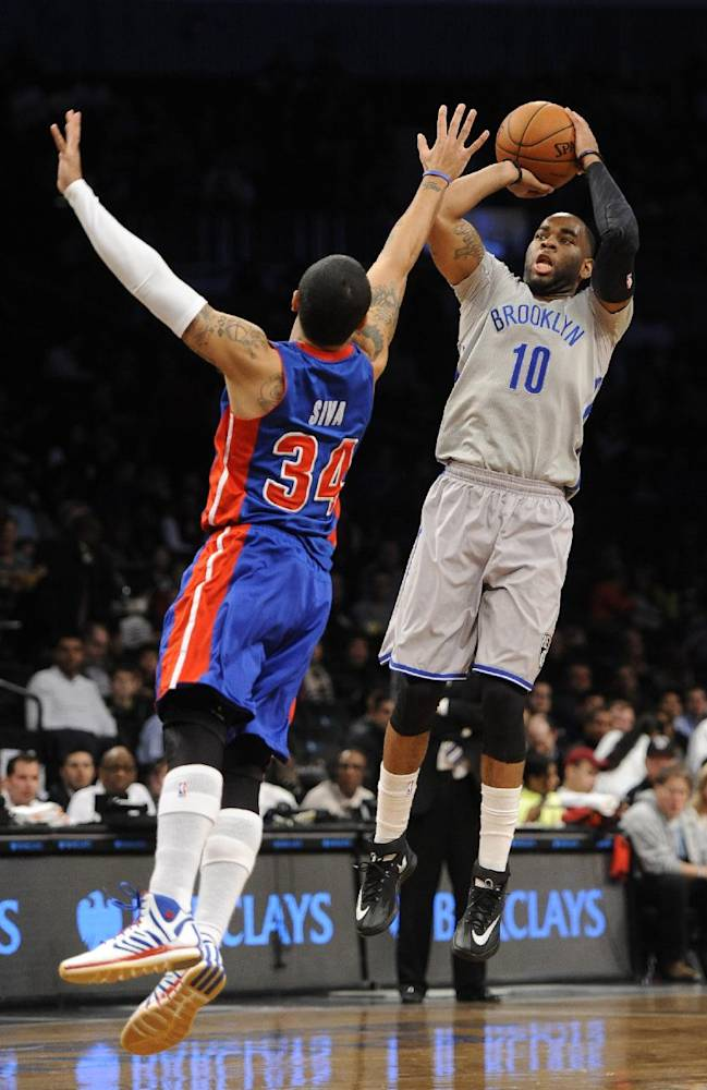 Brooklyn Nets' Marcus Thornton (10) shoots over Detroit Pistons' Peyton Siva (34) in the first half of an NBA basketball game on Friday, April 4, 2014, in New York