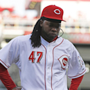 Cincinnati Reds starting pitcher Johnny Cueto walks off the field after giving up a home run to St. Louis Cardinals' Yadier Molina in the seventh inning of a baseball game, Monday, March 31, 2014, on opening day in Cincinnati. St. Louis won 1-0 The Associ