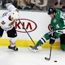 Chicago Blackhawks defenseman Brent Seabrook (7) and Dallas Stars left wing Ryan Garbutt (16) fight for the puck during the second period of an NHL hockey game Saturday, Nov. 9, 2013, in Dallas, Texas The Associated Press