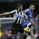 Chelsea's Frank Lampard, right, competes with Newcastle United's Dan Gosling during their English Premier League soccer match at Stamford Bridge, London, Saturday, Feb. 8, 2014