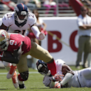 San Francisco 49ers running back Frank Gore, bottom left, is tackled by Denver Broncos cornerback Aqib Talib, top, and free safety Rahim Moore during the first quarter of an NFL preseason football game in Santa Clara, Calif., Sunday, Aug. 17, 2014 The Ass
