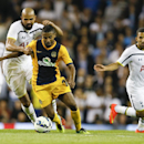 Tottenham's Sandro, left, vies for the ball with AEL Limassol's Diego Barcelos during the second leg Europa League qualifying soccer match between Tottenham Hotspur and AEL Limassol at White Hart Lane stadium in London Thursday, Aug. 28, 2014