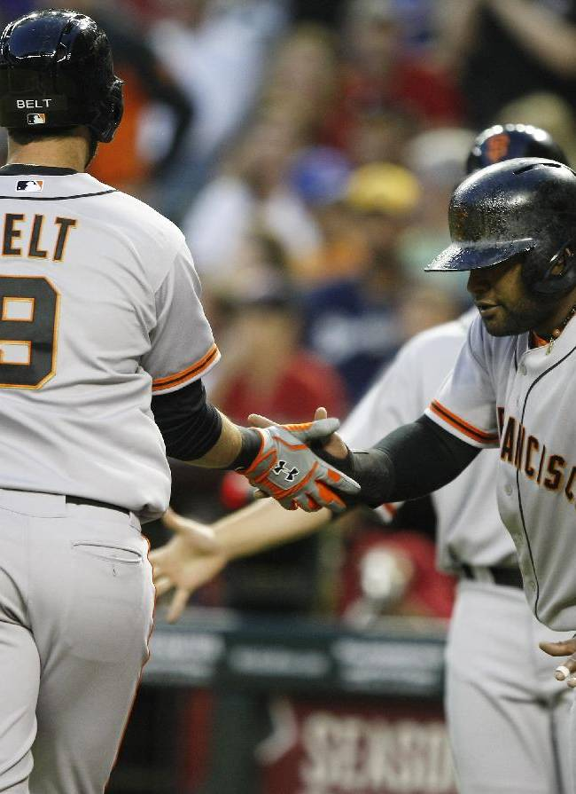 San Francisco Giants first baseman Brandon Belt (9) gets five from Pablo Sandoval (48) after hitting a three run home run in the first inning against the Arizona Diamondbacks during a baseball game, Tuesday, April 1, 2014, in Phoenix