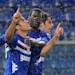 Sampdoria's Eder Citadin Martins, left, celebrates with Petro Obiang and Andrea Poli, right, after scoring during a Serie A soccer match between Sampdoria and Juventus at the Genoa Luigi Ferraris stadium, Italy, Saturday, May 18, 2013. (AP Photo/Carlo Baroncini)