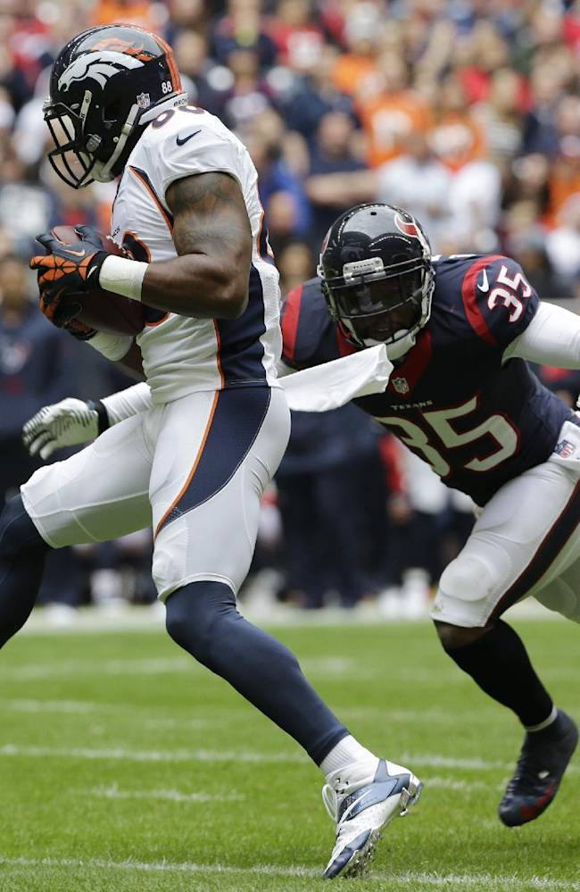 Denver Broncos' Demaryius Thomas, left, makes a catch as Houston Texans' Eddie Pleasant (35) defends on the play during the first quarter of an NFL football game on Sunday, Dec. 22, 2013, in Houston