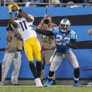 Pittsburgh Steelers' Markus Wheaton (11) catches a pass as Pittsburgh Steelers' Mike Mitchell (23) defends during the first half of an NFL football game in Charlotte, N.C., Sunday, Sept. 21, 2014. The play was ruled incomplete since Wheaton stepped out of bounds before catching the ball. (AP Photo/Mike McCarn)