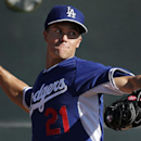 In this Monday, Feb. 10, 2014 file photo, Los Angeles Dodgers pitcher Zack Greinke throws during spring training baseball practice in Glendale, Ariz. It wouldn't bother Zack Greinke if he didn't have to travel for the Los Angeles Dodgers; opener against