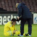 Napoli's Gonzalo Higuain is comforted by a team staffer at the end of a Champions League, group F, soccer match between Napoli and Arsenal, at the Naples San Paolo stadium, Italy, Wednesday, Dec. 11, 2013. Ten-man Arsenal advanced to the Champions League