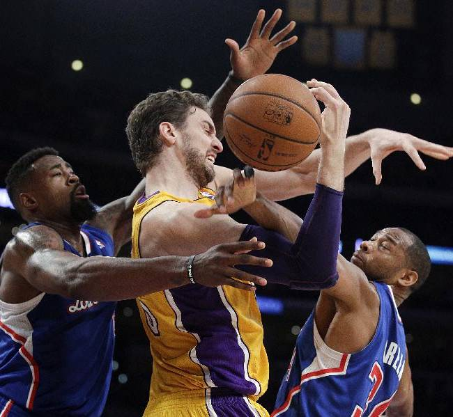 10ThingstoSeeSports - Los Angeles Lakers' Pau Gasol, center, of Spain, is defended by Los Angeles Clippers' DeAndre Jordan, left, and Willie Green during the first half of an NBA basketball game on Thursday, March 6, 2014, in Los Angeles