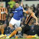 Everton's Kevin Mirallas, left, battles for the ball with Hull City's Michael Dawson during their English Premier League match at Goodison Park, Liverpool England Wednesday Dec. 3, 2014