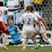 Portland Timbers' Jose Valencia, left, of Colombia, scores the tying goal against Vancouver Whitecaps' goalkeeper Brad Knighton as Jordan Harvey, 2, and Andy O'Brien, 40, of England, defend during the second half of an MLS soccer game in Vancouver, British Columbia on Saturday, May 18, 2013