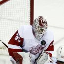 Detroit Red Wings goalie Jimmy Howard (35) blocks a shot in the third period of an NHL hockey game against the Washington Capitals, Wednesday, Oct. 29, 2014, in Washington. The Red Wings won 4-2 The Associated Press