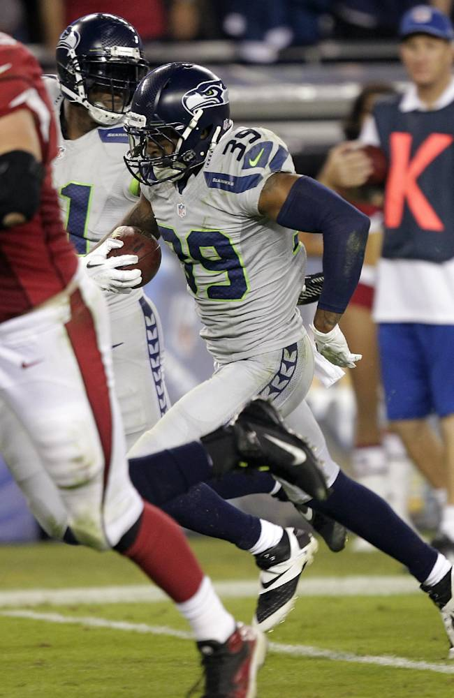 Seattle Seahawks cornerback Brandon Browner (39) runs back an interception against the Arizona Cardinals during the second half of an NFL football game, Thursday, Oct. 17, 2013, in Glendale, Ariz