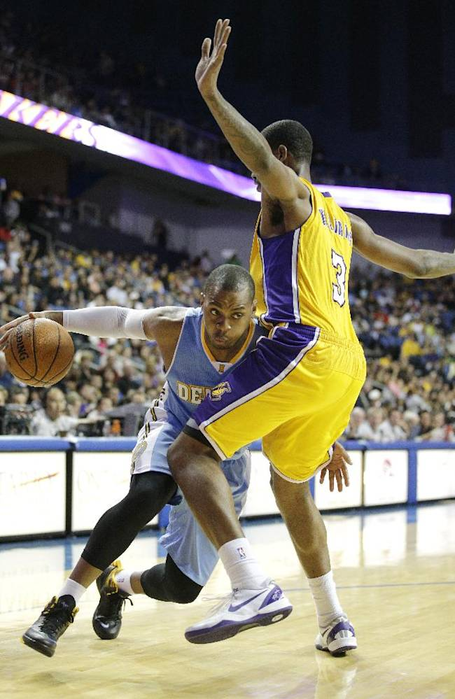 Denver Nuggets' Randy Foye, left, is defended by Los Angeles Lakers' Shawne Williams in the second half of an NBA preseason basketball game on Tuesday, Oct. 8, 2013, in Ontario, Calif. The Lakers won 90-88