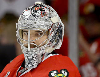 Chicago Blackhawks goalie Corey Crawford (50) takes break during a time out during Game 2 of the NHL hockey Stanley Cup Finals against the Boston Bruins, Saturday, June 15, 2013, in Chicago. (AP Photo/Nam Y. Huh)
