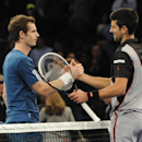 Andy Murray shakes hands with Novak Djokovic after Djokovic won 6-3, 7-6 in the BNP Paribas Showdown Tennis Tournament on Monday, March 3, 2014, in New York. (AP Photo/Kathy Kmonicek)